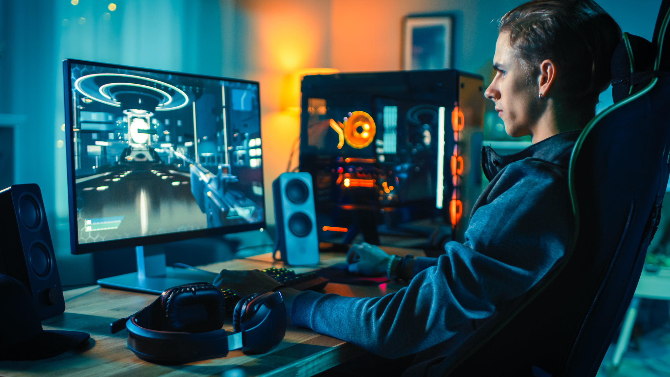 Cheerful Gamer Playing First-Person Shooter Online Video Game on His  Powerful Personal Computer. Room and PC have Colorful Neon Led Lights. Cozy  Evening at Home. - RDS Jeux vidéo